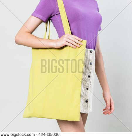 Woman with floral tote bag