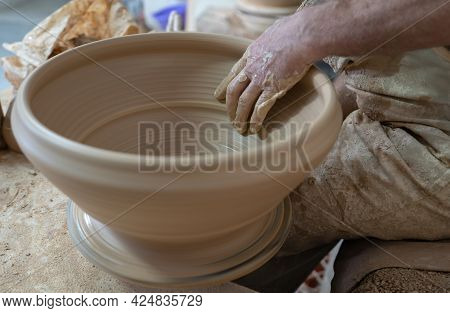 Potter Working Softly On Pot With Hand