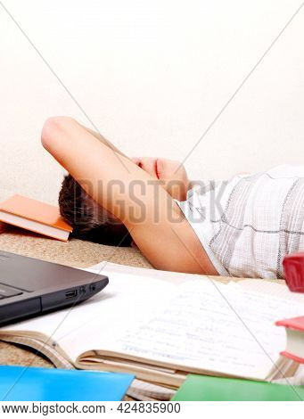 Tired Teenager Sleep With A Books On The Sofa In The Room