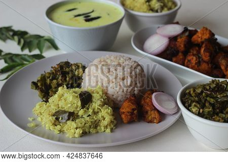 Non Vegetarian Meals Prepared In Kerala Style. The Serving Includes Boiled Red Rice, Stir Fried Onio