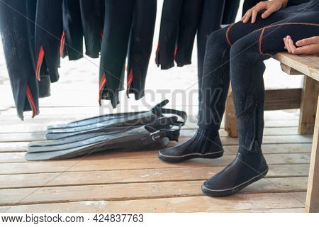 The Diver Puts On Fins. Diver And Equipment. Wetsuit Fins And Diving Equipment Close-up
