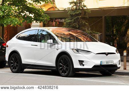Kiev, Ukraine - May 22, 2021: Tesla Model X White Electric Car Parked In The City