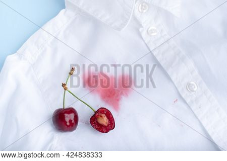Close Up Cherry Stains From Clothes. Juice Stain With Stain For Clothes.
