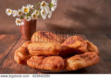 Fried Peremyachi, Belyashi, Meat Pies On A Dark Background. Traditional Russian Pies. Russian,
