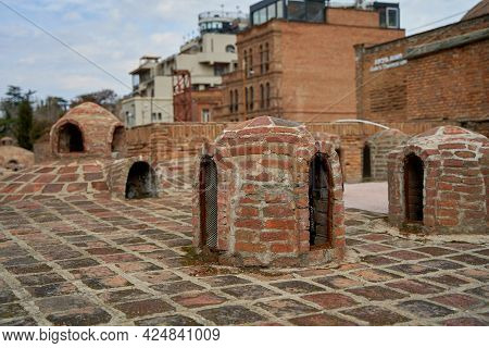Popular City Landmark In Tbilisi. Ancient Underground Complex Of Sulfur Baths.