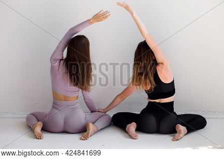 Beautiful Sporty Women Do Exercises On A White Background. Fitness.