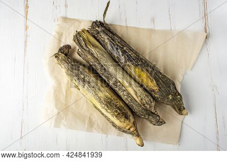 Spoiled Moldy Food. Cobs Of Corn With Mold On White Background.