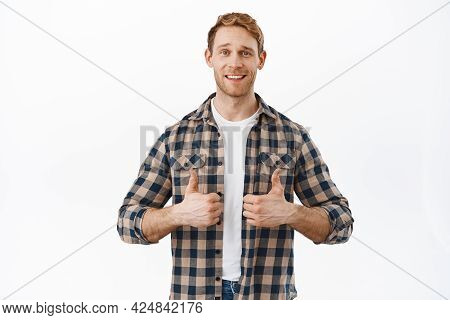 Sounds Good. Attractive Redhead Adult Man Showing Thumbs Up And Smiling Happy, Satisfied With Qualit