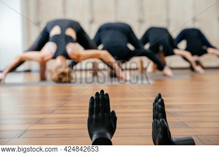 Group Of Women Practicing Yoga Stretching Using Wooden Blocks, Exercise For Spine And Shoulders Flex