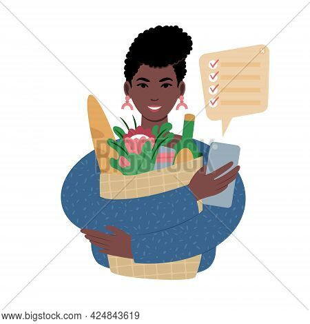 Young African Woman With Groceries Bag And A Shopping List On A Smartphone.