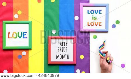 Rainbow Lgbt Flag Background With Frames, Fan, Pencils And Ribbons. Hand With Painted Nails.paper Co