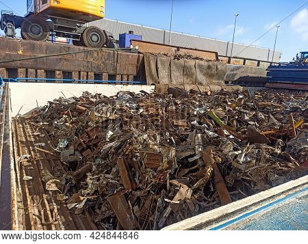 Loading And Unloading Of Scrap Metal In The Port On The Berth From The Hold Of The Ship. Reuse Of Re