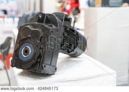 Close Up Reducer Gearbox And Electric Motor For Manufacturing Machine On Table