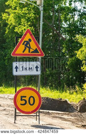 Sign Road Works And Speed Limit On Dangerous Road Section, Road Repair, Danger, Road Construction.