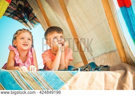 Kids Camping. Brother And Sister Playing Together. Happy Kid Family Playing In Tent. Having Fun Outd