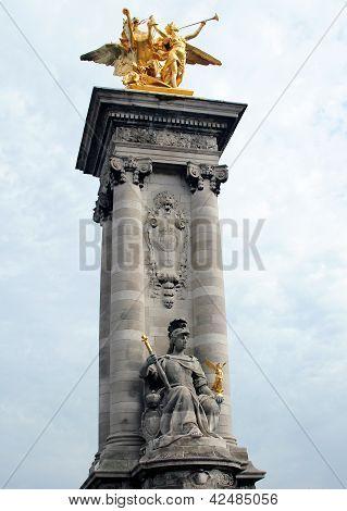 Golden statue on Pont Alexandre III in Paris