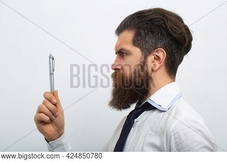 Business Man In Shirt And Tie Holding Note Pad And Pen. Close Up Profile Of Surious Man. Idea. Portr