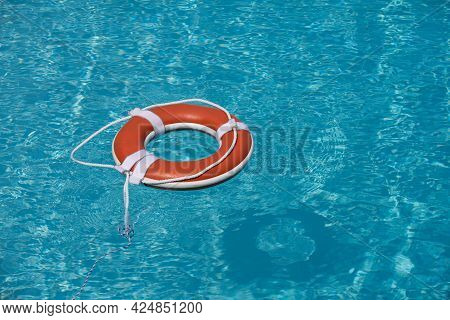 Preserver Lifebuoy. Orange Lifebuoy In Sea On Water. Life Ring Floating Of Water.