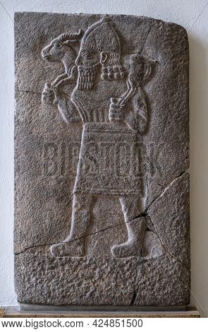 Berlin, Germany - 18 September 2019: Babylonian bas relief in museum. Historical ancient art of east religion and civilization. Antique islamic decoration