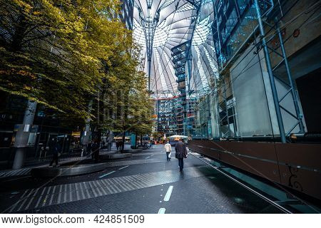 Berlin, Germany - 20 September 2019: People walking along Sony center in Berlin, Germany