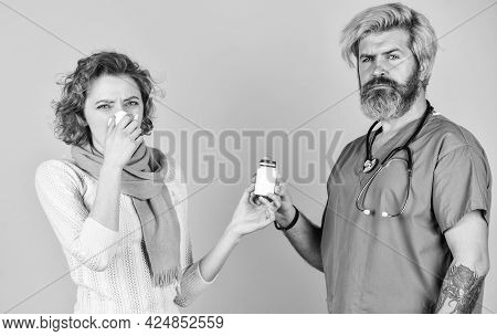 Healthcare And People. Patient And Doctor Hold Pills. Woman With Runny Nose At Nurse Consultation. P