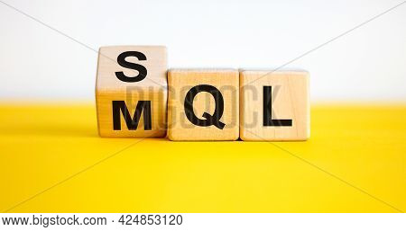 Sql Or Mql Symbol. Turned Wooden Cubes And Changed Words 'mql Marketing Qualified Lead' To 'sql Sale