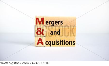 Mergers And Acquisitions Symbol. Concept Words 'm And A, Mergers And Acquisitions' On Wooden Blocks