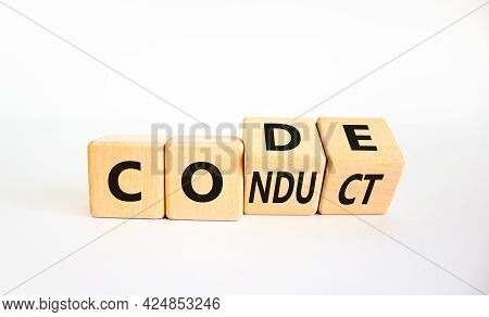 Code Of Conduct Symbol. Turned The Wooden Cube And Changed The Word Code To Conduct. Beautiful White