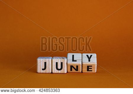 From June To July Symbol. Turned Wooden Cubes And Changed The Word 'june' To 'july'. Beautiful Orang
