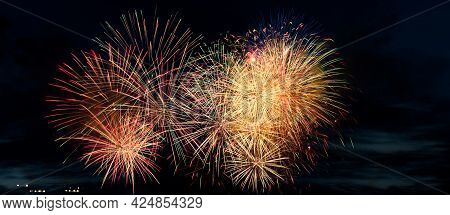 Colorful Fireworks On A Black Background. Celebration And Holidays Concept. Independence Day 4th Of