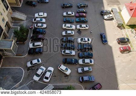 Nur-sultan. Kazakhstan: 04.09.2013 - Parking In The Residential Center. Residential Buildings Are Ye