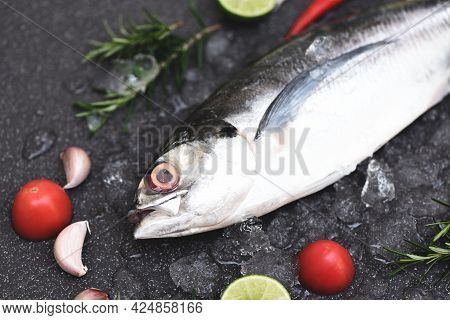 Fish On Ice For Cooking Food In The Restaurant, Fresh Fish Raw Torpedo Scad With Lemon Herb And Spic