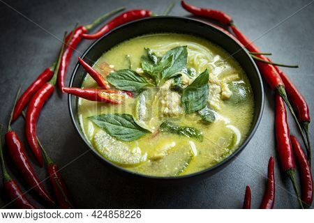 Chicken Green Curry Thai Food On Soup Bowl With Ingredient Vegetable Herbs And Spices Pepper Chili,