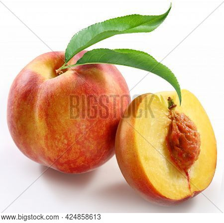 Peaches, Isolated Peaches. One Whole Pink Peach With Leaf And A Half Isolated On White Background