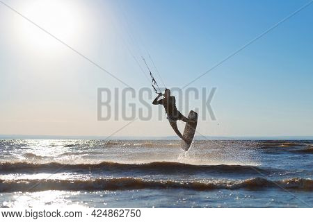 Kiteboarder Surfing Waves With Kiteboard On A Sunny Summer Day.