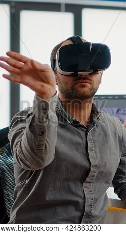 Video Editor Experiencing Virtual Reality Headset, Gesturing, Editing Film Montage Using Post Produc