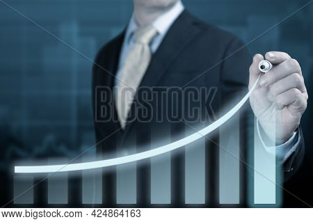 Businessman Pointing Graph Corporate Future Growth Plan. Business Development To Success And Growing