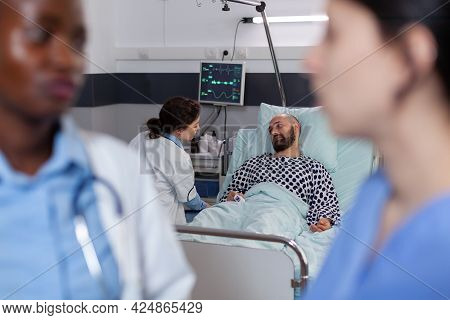 Physician Doctor With Black Skin Talking With Medical Asisstant During Recovery Consultation Working