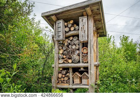 Wooden Insect House In The Garden. Bug Hotel In Natural Environment. Insect Hotel In Switzerland. Sh
