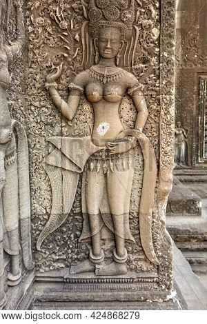 A Bas-relief On The Wall Of An Ancient Temple In Angkor. The Figure Of An Apsara Dancer Is Carved On