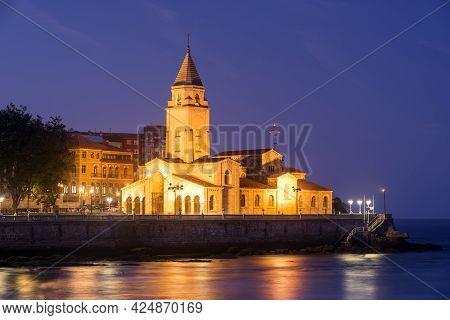 Gijon, Spain - September 28, 2019: San Pedro Church Of Gijon At Night Located Near Of San Lorenzo Be