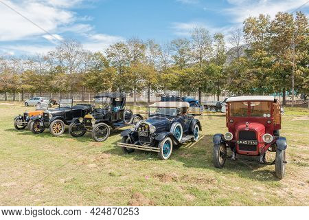 Villiersdorp, South Africa - April 12, 2021: Vintage Cars On Display. Left To Right,: Morris Minor,
