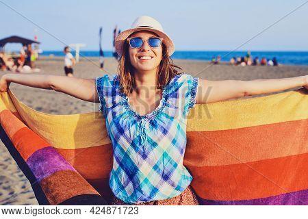 Traveler gay girl relaxing on tropical beach in vacation. Young gay girl traveler relaxing in vacation. Traveler relaxing on tropical beach in vacation. Gay Girl in vacation relaxes on beach in summer day. Gay Traveler. Summer. Vacations.