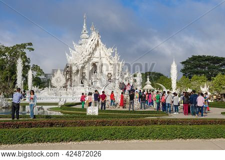 Chiang Rai, Thailand - December 16, 2018: Tourists At The Futuristic Buddhist Temple Wat Rong Khun (