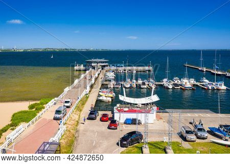 Pier and beach in Puck on the Bay of Puck at summer. Poland