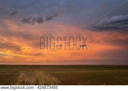spectacular sunset sky over a green prairie - Pawnee National Grassland in Colorado, aerial view of late spring or early summer scenery