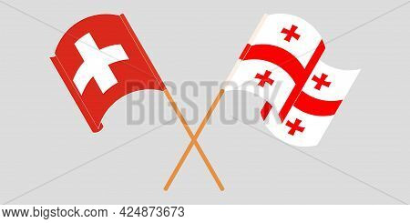 Crossed And Waving Flags Of Georgia And Switzerland
