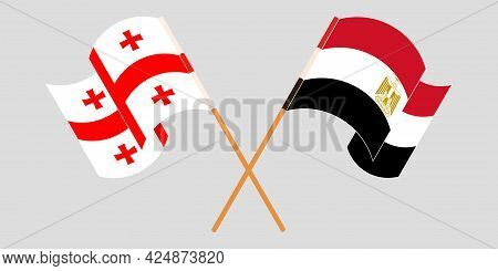 Crossed And Waving Flags Of Georgia And Egypt