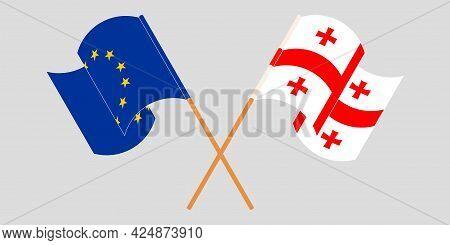 Crossed And Waving Flags Of Georgia And The Eu