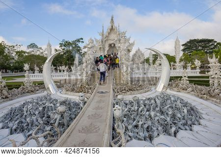Chiang Ray, Thailand - December 16, 2018: At The Entrance To The Wat Rong Khun Buddhist Temple (whit